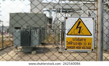 Warning symbol Danger High Voltage 22 KV Thailand. - stock photo