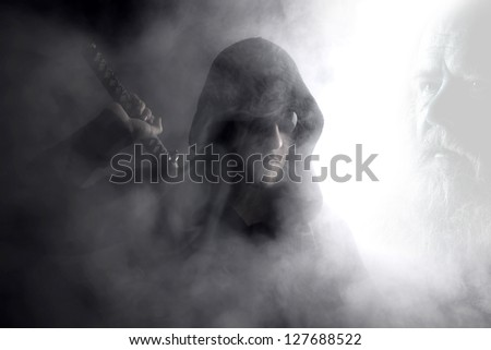 warrior in smoke with ancestor's tale - stock photo