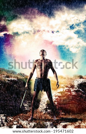 Warrior with sword staying in the rain and gathering storm is looking in the sky - stock photo