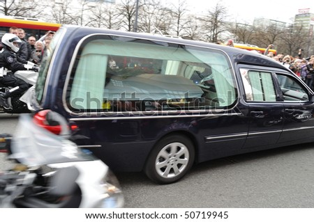 WARSAW - APRIL 11: Hearse carrying the coffin of Polish president, who was killed in a plane crash in Russia. April 11, 2010 in Warsaw, Poland. - stock photo