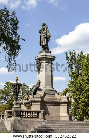 WARSAW - AUGUST 16: Adam Mickiewicz statue by Cyprian Godebski unveiled on December 24, 1898, removed in 1942 by the Germans, once again unveiled January 28, 1950, in Warsaw, Poland on August 16, 2013