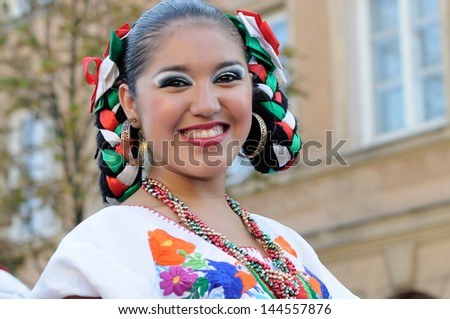 "WARSAW - AUGUST 27: Dancer of folklore ensemble ""VALLARTA AZTECA"" from Mexico - street parade during the International Folklore Festival ""WARSFOLK"" ; on August 27, 2011 in Warsaw, Poland. - stock photo"
