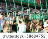 WARSAW - AUGUST 7 : Football fans in Legia Warsaw New Stadium during the friendly match between Legia Warsaw and Arsenal London on August 7, 2010 in Warsaw, Poland. - stock photo