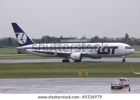 WARSAW - AUGUST 31: LOT Airlines Boeing 767 August 31, 2010 at Warsaw Chopin airport, Poland. The aging fleet of LOT's 767 is going to be replaced by Boeing 787, LOT is launch customer for Europe. - stock photo