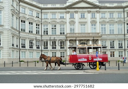 WARSAW - AUGUST 10: Tourist horse-drawn tram in front of the Jablonowski palace on August 10, 2010 in Warsaw, Poland. - stock photo