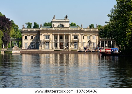 WARSAW CITY, POLAND - MAY 20, 2011: Tourists visiting the Royal Palace on the Water in Lazienki Park (Royal Baths Park), major tourist attraction in Warsaw
