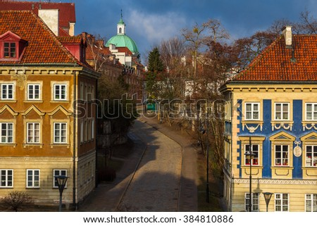 warsaw colorful houses and a narrow street on a sunny autumn day - stock photo