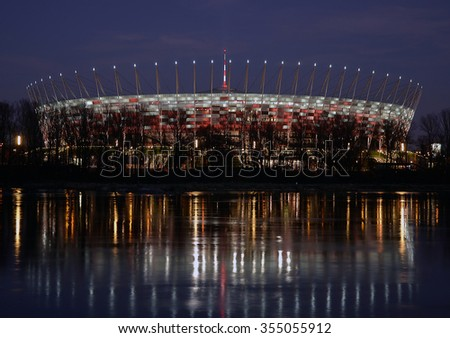 WARSAW - DECEMBER 19: Illumination of the facade National Stadium in Warsaw on December 19, 2015 in Warsaw, Poland. At this stadium will be the opening match of Euro 2012. - stock photo