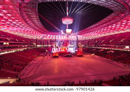 WARSAW - JANUARY 29: Visitors at the grandstand, during The Grand Open Day at the National Stadium and a performance by the Polish band Lady Pank on January 29, 2012 in Warsaw, Poland. - stock photo