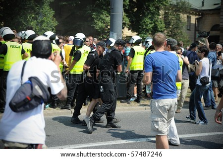 WARSAW - JULY 17: gay Europride 2010 in Poland, youth aggressive nationalist opponents of the parade blocked by police, July 17, 2010 in Warsaw, Poland.