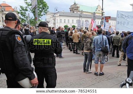 WARSAW - MAY 27: Protesters people gathered in front of the presidential palace, while U.S. President Barack Obama arrival to Poland on May 27, 2011 in Warsaw, Poland. - stock photo