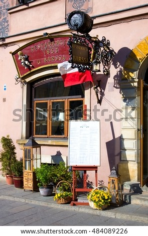 WARSAW, POLAND - APRIL 21, 2016: Restaurant on Warsaw's Old Town Market Place (Rynek Starego Miasta) on  sunny day. Center and oldest part of Warsaw