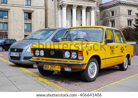 WARSAW, POLAND - APRIL 16, 2016: The historic Fiat 125p an icon of Polish automobile. This car advertises a tourist company famous because of individually organized tours for tourists coming to town - stock photo