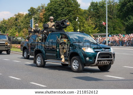 WARSAW, POLAND - AUGUST 15, 2014: GROM - elite counter terrorism units in Toyota Hilux. Polish Armed Forces Day. 1200 Polish, over 90 foreign soldiers, over 120 military vehicles, over 50 air crafts - stock photo