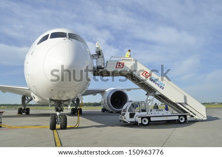 WARSAW, POLAND - AUGUST 4: New Boeing 787 Dreamliner of the LOT Polish Airlines - crew prepare the aircraft for departure at Chopin Airport on August 4, 2013 in Warsaw, Poland.  - stock photo