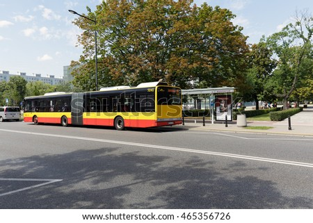 WARSAW, POLAND - AUGUST 05, 2016: Public bus stopped at the bus stop that is located by the park next to Museum of the History of Polish Jews