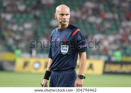 WARSAW, POLAND - AUGUST 06, 2015: Referee Tony Chapron during UEFA Europe League football match between Legia Warsaw and FK Kukesi in Warsaw. - stock photo