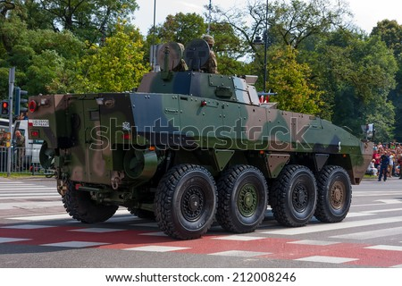 WARSAW, POLAND - AUGUST 15, 2014: Wheeled Armored Vehicle ROSOMAK,  Wolverine. Polish Armed Forces Day. Over 1200 Polish and over 90 foreign soldiers, over 120 military vehicles, over 50 aircrafts - stock photo