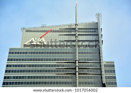 Warsaw, Poland. 3 February 2018. Axa sign neon. WTT Tower.
