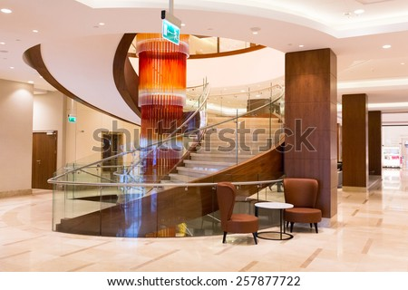 WARSAW, POLAND - 28 FEBRUARY 2014: Lobby and hall of DoubleTree by Hilton Hotel & Conference Centre in Warsaw, Poland. DoubleTree by Hilton has over 400 hotels and resorts around the world. - stock photo
