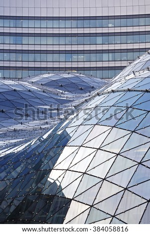 Warsaw, Poland - February 28, 2016: The glass roof of a modern shopping mall called Golden Terraces (Zlote Tarasy) is a fragment of a bigger commercial, office and the entertainment complex