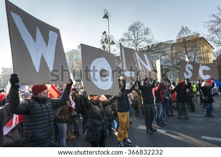 """WARSAW, POLAND - JANUARY 23, 2015: Supporters of democracy during a march organized by the Committee for the Defence of Democracy (KOD) entitled """"In defense of your freedom.""""  - stock photo"""