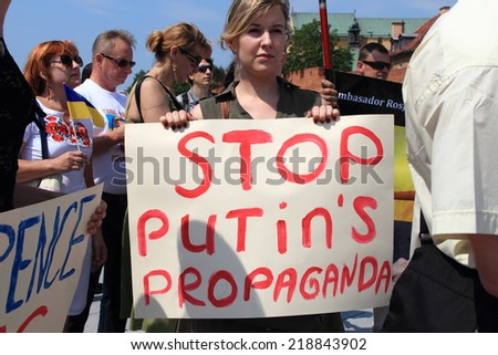 WARSAW, POLAND - JULY 27, 2014: The pro-Ukrainian protest against policy of the President of Russia Vladimir Putin. - stock photo