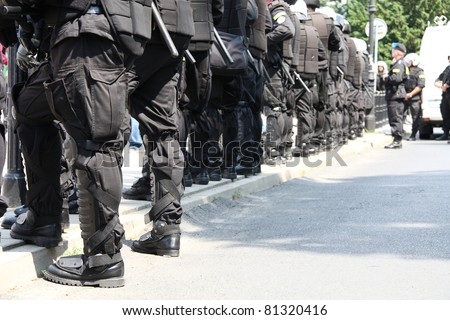 WARSAW, POLAND - JUNE 30:  Closeup of a police cordon protecting government buildings during anti government Solidarity demonstration on June 30, 2011 in Warsaw, Poland. - stock photo