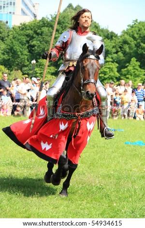 WARSAW, POLAND - JUNE 6: Knight on horseback during XV Knight Tournament on June 6, 2010 in Warsaw, Poland. - stock photo
