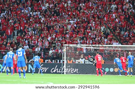 WARSAW, POLAND - MAY 27, 2015: FC Dnipro players score a goal during UEFA Europa League Final game against FC Sevilla at Warsaw National Stadium - stock photo