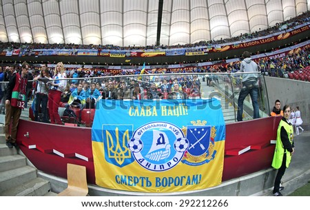 WARSAW, POLAND - MAY 27, 2015: FC Dnipro team supporters show their support during UEFA Europa League Final game against Sevilla at Warsaw National Stadium - stock photo