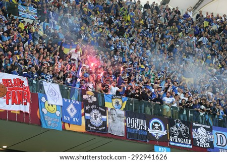 WARSAW, POLAND - MAY 27, 2015: FC Dnipro team ultra supporters (ultras) show their support during UEFA Europa League Final game against Sevilla at Warsaw National Stadium - stock photo