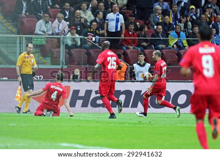 WARSAW, POLAND - MAY 27, 2015: FC Sevilla players celebrate after Grzegorz Krychowiak (L) scored a goal during UEFA Europa League Final game against FC Dnipro at Warsaw National Stadium - stock photo