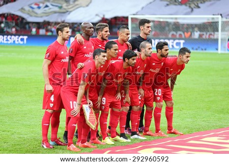 WARSAW, POLAND - MAY 27, 2015: FC Sevilla players pose for a group photo before UEFA Europa League Final game against FC Dnipro at Warsaw National Stadium - stock photo