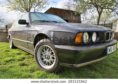 Warsaw, POLAND - May 2, 2015: German vehicle BMW (E34 520i) after rain on May 2, 2015 in Warsaw, Poland.