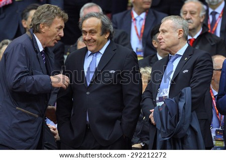 WARSAW, POLAND - MAY 27, 2015: Head of Polish FA Zbigniew Boniek (L), UEFA President Michael Platini (C) and UEFA Vice-president Hryhoriy Surkis during UEFA EL Final game between Dnipro and Sevilla - stock photo
