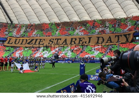 WARSAW, POLAND - MAY 2, 2016: Legia Warsaw fanatical fans during Polish Cup final football match between Legia Warszawa and Lech Poznan at the National Stadium in Warsaw. - stock photo