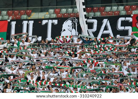 WARSAW, POLAND - MAY 02, 2015: Legia Warsaw ultra fans during Polish Cup Final football match between Legia Warsaw and Lech Poznan at the National Stadium in Warsaw. - stock photo