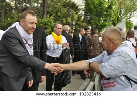 WARSAW, POLAND - MAY 11: Parliamentarians meets with the members of Solidarity trade union, during a protest action against the pension reform on May 11, 2012 in Warsaw, Poland.