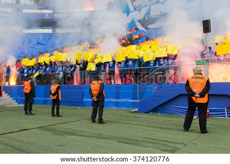 WARSAW, POLAND - MAY 02, 2015: Unidentified fans of Lech Poznan during Polish Cup Final football match between Legia Warsaw and Lech Poznan at the National Stadium in Warsaw. - stock photo