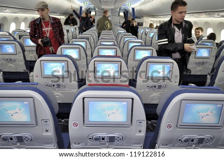 WARSAW, POLAND - NOVEMBER 16: The interior of the new Boeing 787 Dreamliner - First Dreamliner purchased by Polish national carrier LOT - on November 16, 2012 in Warsaw, Poland. - stock photo