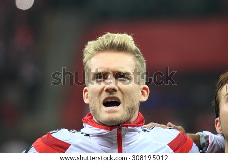 WARSAW, POLAND - OCTOBER 11, 2014: Andre Schurrle (German team and Bundesliga club VFL Wolsburg player) before the UEFA EURO 2016 qualifying match of Poland vs. Germany. Poland beat Germany 2:0 - stock photo
