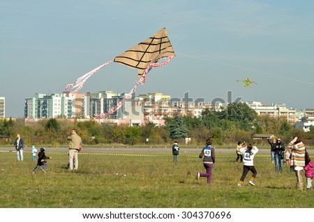 WARSAW, POLAND - OCTOBER 10, 2010: Contestants flying a kites during the Warsaw Championships Youngsters in competition kites. - stock photo