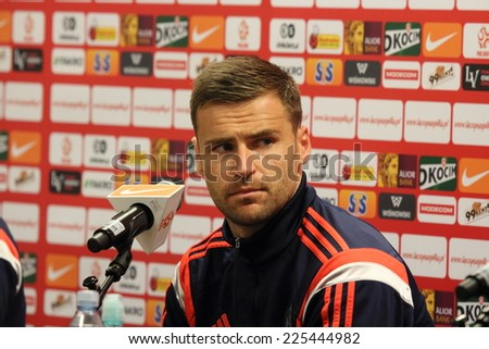 WARSAW, POLAND - OCTOBER 13, 2014: David Marshall, goalkeeper of the Scotland national football team attends a press conference before the UEFA EURO 2016 qualifying match of Poland vs. Scotland - stock photo