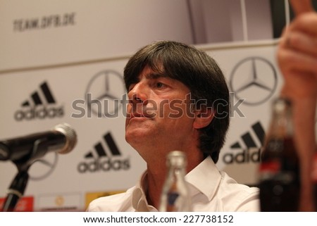 WARSAW, POLAND - OCTOBER 10, 2014: Joachim Loew, head coach of the German national football team attends a press conference before the UEFA EURO 2016 qualifying match of Poland vs. Germany.  - stock photo