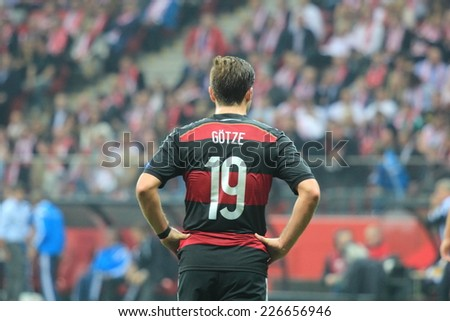 WARSAW, POLAND - OCTOBER 11, 2014: Mario Gotze in action (German team and Bundesliga club Bayern Munich player) during the UEFA EURO 2016 qualifying match of Poland vs. Germany - stock photo