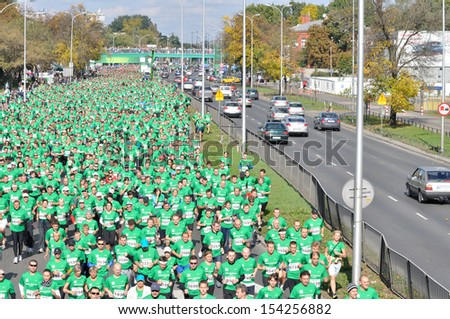 WARSAW, POLAND - OCTOBER 3: More than 9000 runners compete in the Run Warsaw a 10km race on through the main streets of city, October 3, 2010 in Warsaw, Poland.