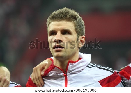 WARSAW, POLAND - OCTOBER 11, 2014: Thomas Muller (German team and Bundesliga club Bayern Munich player) before the UEFA EURO 2016 qualifying match of Poland vs. Germany. Poland beat Germany 2:0 - stock photo