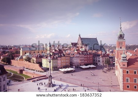 Warsaw, Poland. Old Town - famous Royal Castle on the right. UNESCO World Heritage Site. Cross processed color tone - retro filtered style. - stock photo