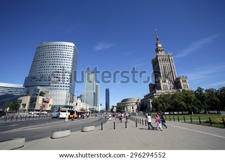 WARSAW, POLAND - SATURDAY, JUNE 6, 2015: A general view of the skyline of Warsaw, including the palace of culture, at right.   - stock photo